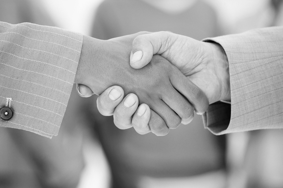 bigstockphoto_Business_People_Shaking_Hands__4035637